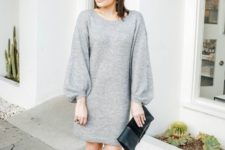 With black clutch and black ankle boots