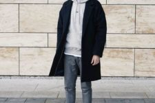 With black coat, gray trousers, white sneakers and beanie