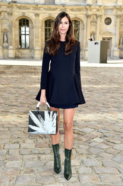 With black dress and unique bag