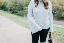 With black pants, gray over the knee boots and black bag