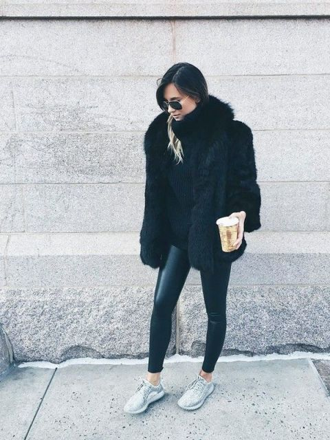 With black sweater, black leather pants and black fur coat