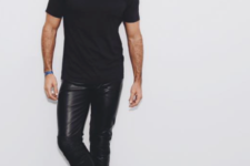 With black t-shirt and black leather boots
