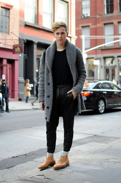 With black t-shirt, leather pants, light brown shoes and black bag