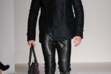 With black turtleneck, tweed coat and big bag