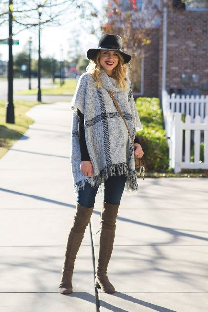 With black wide brim hat, jeans, crossbody bag and gray boots