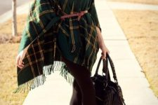 With brown belt, skirt, black tights, black bag and brown ankle boots