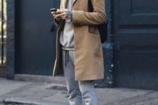 cool men's winter outfit with a baseball cap