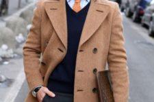 With brown coat, shirt, orange tie, printed clutch and black pants