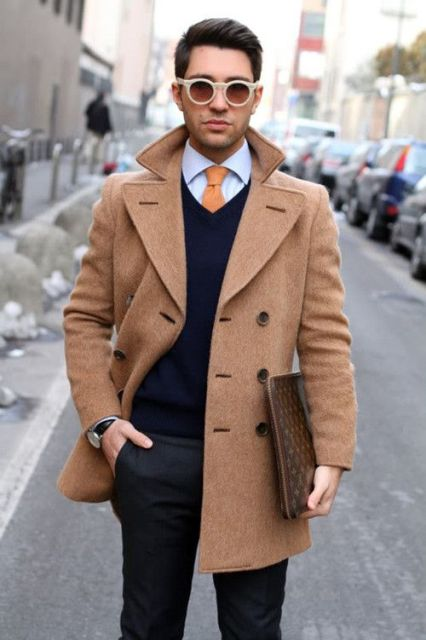 With brown coat, shirt, orange tie, printed clutch and black pants