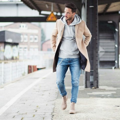 With brown coat, skinny jeans and beige boots