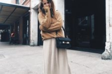 With brown sweater, beige midi skirt and black small bag