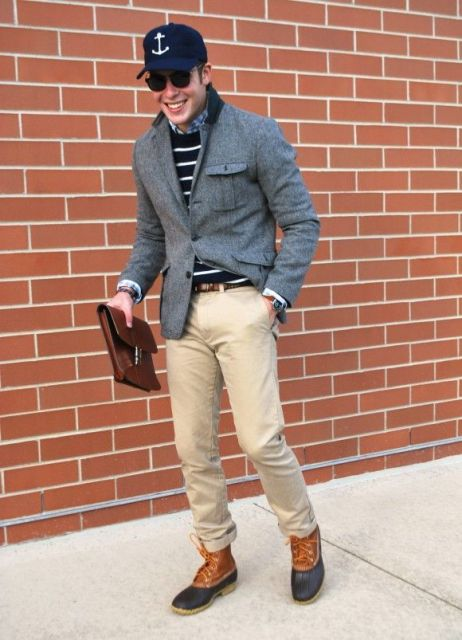 With cap, gray jacket, beige pants, brown bag and lace up boots
