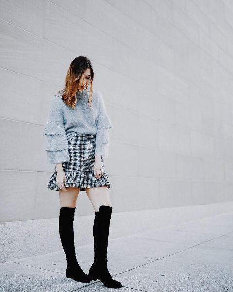 With checked high-waisted skirt and black over the knee boots