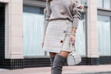 With checked wrap skirt, mini bag and gray suede over the knee boots