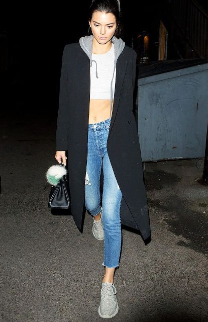 With crop top, hoodie, black coat, crop jeans and mini bag