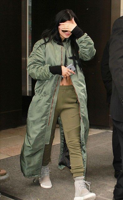 With crop top, olive green sporty pants and green maxi coat