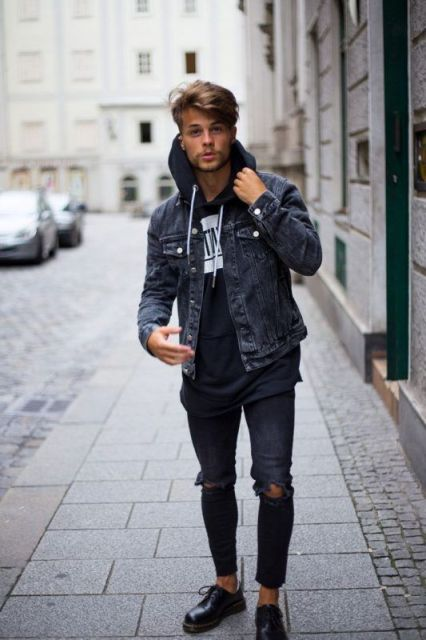 With denim jacket, distressed jeans and black shoes