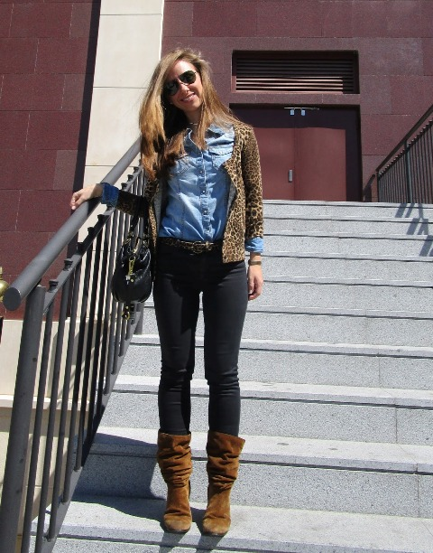 With denim shirt, leopard jacket, dark colored pants and black bag