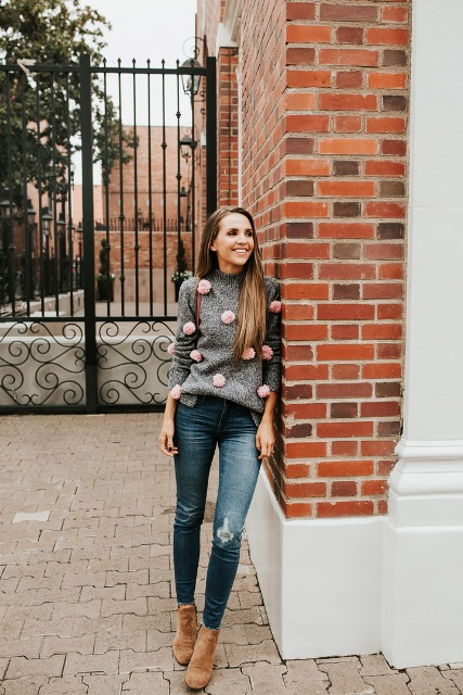 With distressed jeans and brown suede ankle boots
