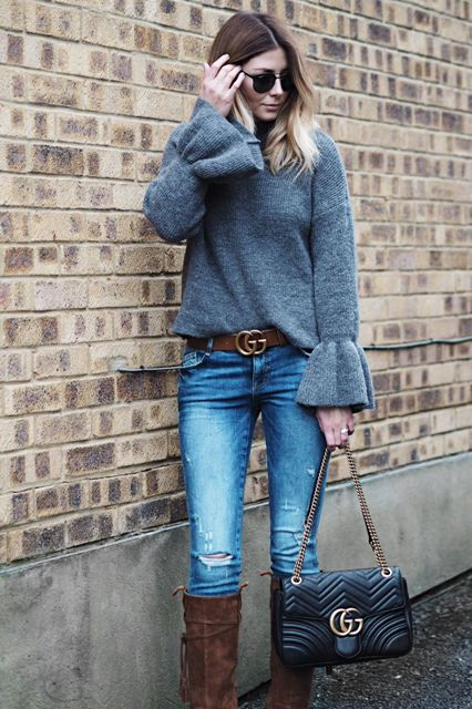 With distressed jeans, brown belt, sunglasses, brown suede boots and chain strap bag