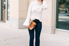 With flare pants, brown leather clutch and beige shoes