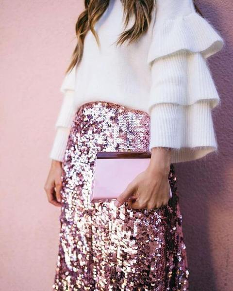 With glitter skirt and pale pink clutch