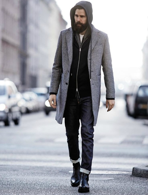 With gray coat, cuffed jeans and black boots