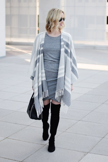 With gray dress, black bag and black over the knee boots