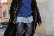 With gray loose t-shirt, blue hoodie, fur coat and lace up boots