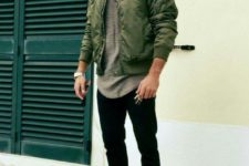 With gray t-shirt, black pants and olive green bomber jacket