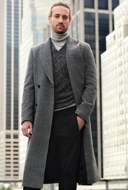 With gray turtleneck, gray knee length coat and black pants