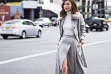 With gray turtleneck, gray midi coat and gray leather ankle boots