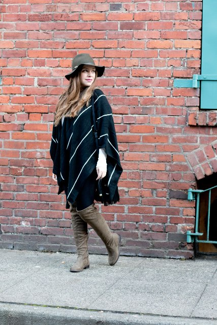With gray wide brim hat, black pants and gray suede over the knee flat boots