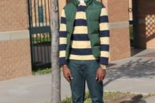 With green puffer vest, cuffed jeans and shoes