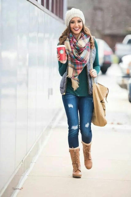 With green shirt, puffer vest, distressed jeans, hat, plaid scarf and tote