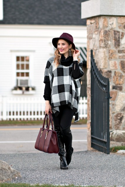 With hat, marsala bag, black trousers and leather boots