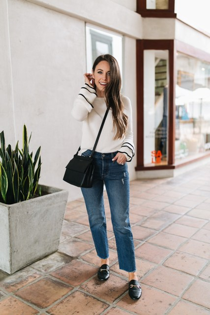 With jeans, black flat shoes and black crossbody bag