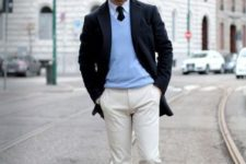 With light blue shirt, black tie, black blazer, white pants and pastel colored shoes