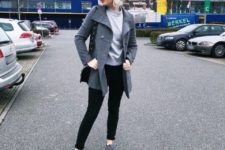 With light gray sweatshirt, gray beanie hat, black pants, black bag and gray coat