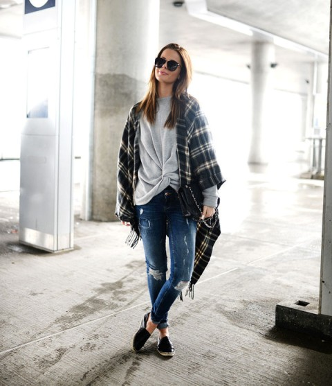 With loose sweatshirt, distressed jeans and flat shoes