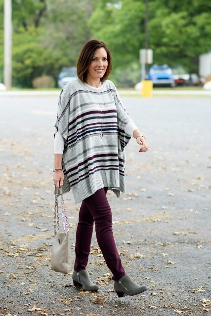 With marsala pants, gray ankle boots and chain strap bag