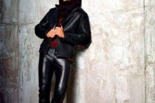 With marsala shirt, black leather jacket, black shoes and dark colored scarf