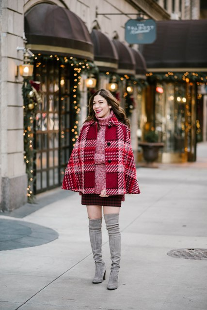 With mini skirt and gray over the knee heeled boots