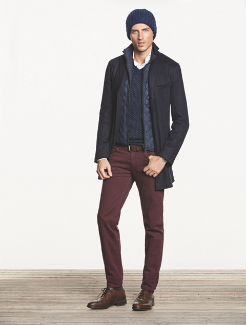 With navy blue beanie, white shirt, puffer vest, coat, marsala pants and lace up boots
