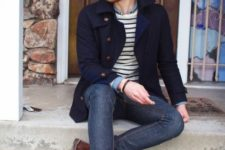 With navy blue jacket, jeans and boots