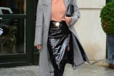 With peach shirt, checked coat, over the knee boots and black clutch