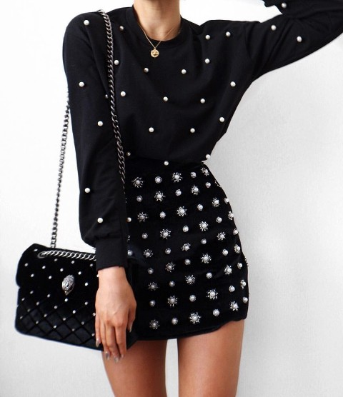 With pearl mini skirt and black pearl chain strap bag