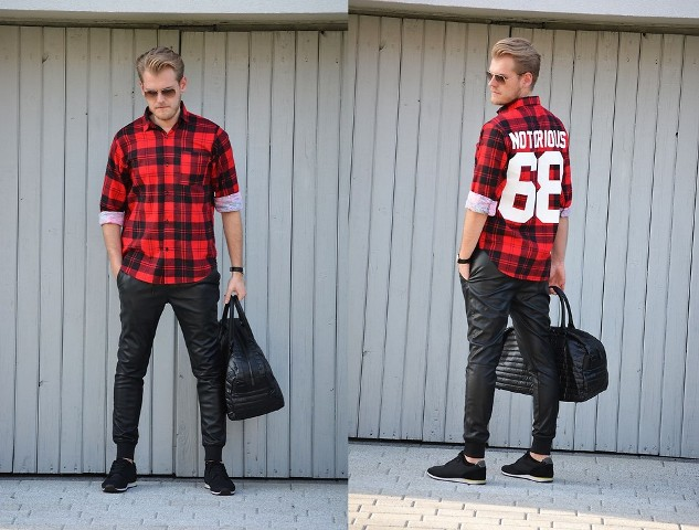 With plaid button down shirt, black sneakers and black big bag