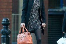 With printed dress, black tights, black coat and brown leather bag