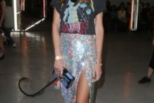 With printed t-shirt, glitter midi skirt and blue and black clutch
